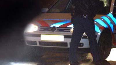 Foto van politieauto in het donker | Archief EHF