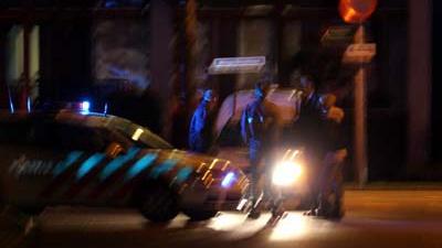Foto van politieauto zwaailicht donker   Archief EHF