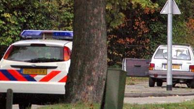 Foto van politieauto en personenauto | Archief EHF