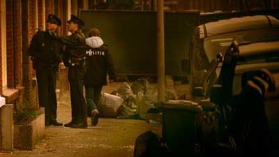 Foto van politiemensen bij woning | Archief EHF