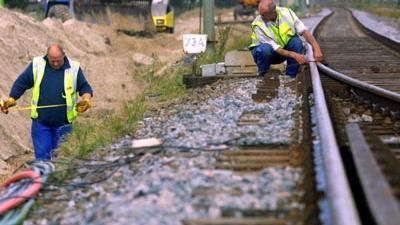 Foto van spoor arbeider rails trein | Archief EHF