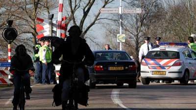 Foto  van spoorwegovergang politie | Archief EHF