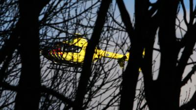 Foto van traumaheli tussen bomen | Archief EHF
