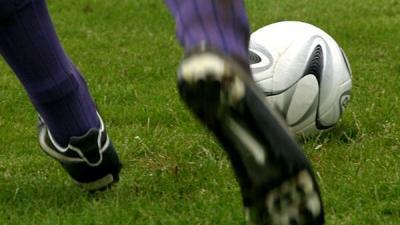 Foto van voetballer met bal